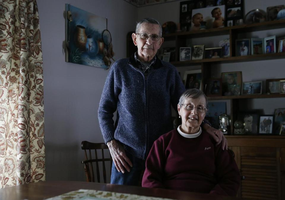 Dover-Foxcroft, ME, 01/16/2019 -- Ted Marshall, 87, and his wife, Jane pose for a portrait inside their home. Dover-Foxcroft, like nearly all Maine towns, is aging rapidly. But, unlike many other communities, they're planning aggressively for a silver-haired future. (Jessica Rinaldi/Globe Staff) Topic: 20maine Reporter: