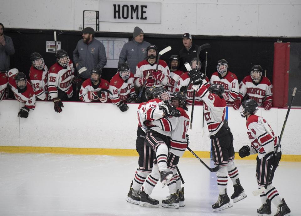 Quincy, MA - 1/16/2019 - North Quincy High School hockey players celebrate #17 Noah Wines goal. North Quincy vs Duxbury at the Quincy Yourth Center. (John Cetrino for The Boston Globe) Sports Don McLoone
