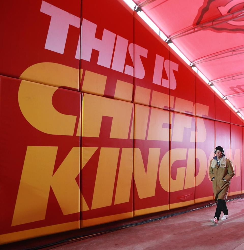 "01-20-19: Kansas City, MO: After checking out the field conditions before the game, Patriots quarterback Tom Brady heads back up the ramp to the visitor's locker room past a giant sign in the wall that reads ""This Is Chiefs Kingdom"". The New England Patriots visited the Kansas City Chiefs for the AFC Championship Game at Arrowhead Stadium. (Jim Davis /Globe Staff)"