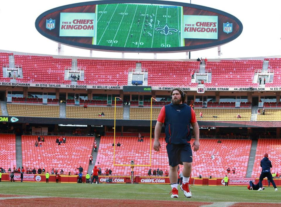 01-20-19: Kansas City, MO: Before the game, Patriots center David Andrews was on the field in shorts while the NFC Championsgip game was being shown on the screen behind him. The New England Patriots visited the Kansas City Chiefs for the AFC Championship Game at Arrowhead Stadium. (Jim Davis /Globe Staff)