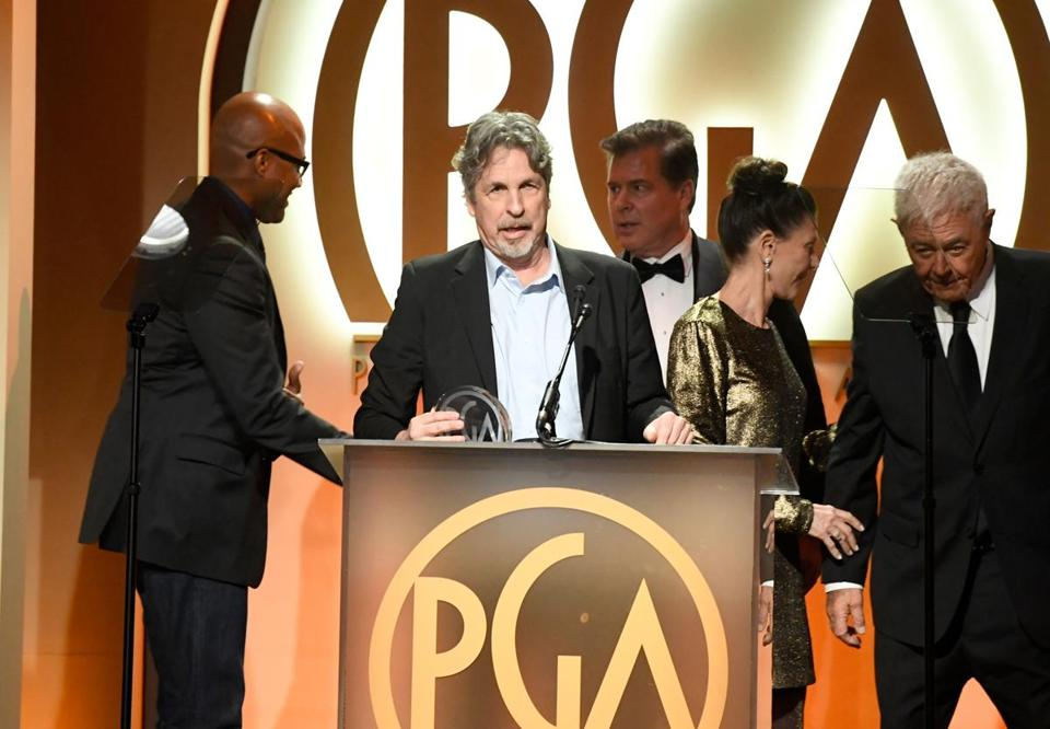 """Green Book"" producer Peter Farrelly (second from left) accepted the award Saturday at the Producers Guild Awards event."
