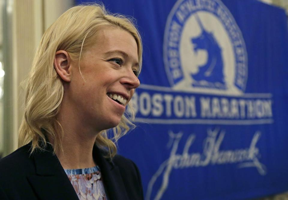 In this photo taken Thursday, April 14, 2016, Adrianne Haslet, a 2013 Boston Marathon survivor, speaks at a news conference, Thursday, April 14, 2016, in Boston after receiving the Patriots' Award, which is annually given to a New England-based individual, group, or organization that is patriotic, philanthropic, and inspirational, and fosters goodwill and sportsmanship. (AP Photo/Elise Amendola)