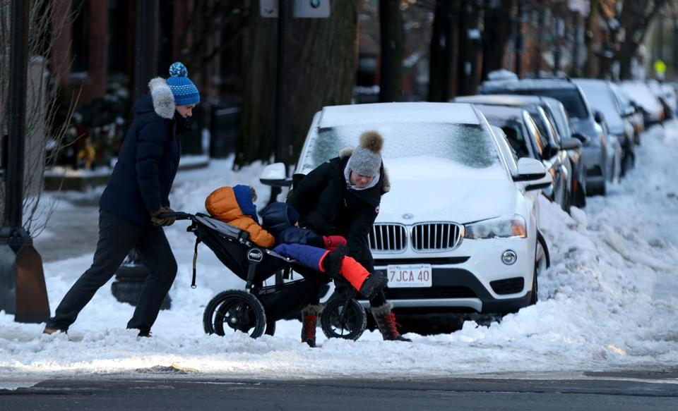 01/22/2019 Boston MA -Pedestrians on Dartmouth Street had to deal with ice and cold temperatures. Jonathan Wiggs/Globe StaffReporter:Topic: