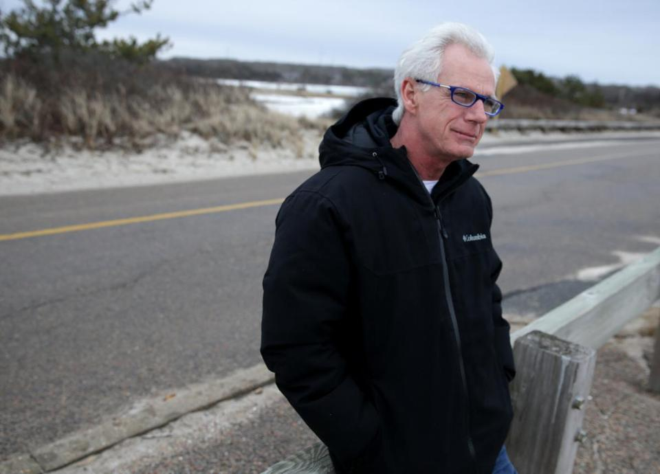 01/23/2019 Falmouth MA -Dave Moriarty (cq) is a opponents of the town of Falmouth's wind turbines People have complained, that they are eyesores, and even cause neighbors physical harm. He is photographed at the town's Chappy Beach. .Jonathan Wiggs/Globe StaffReporter:Topic: