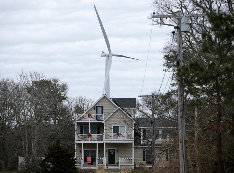 01/23/2019 Falmouth MA - A wind turbine looms over the Craggy Ridge neighborhood in West Falmouth. Opponents of the town of Falmouth's wind turbines,have complained, that they are eyesores, and even cause neighbors physical harm. .Jonathan Wiggs/Globe StaffReporter:Topic: