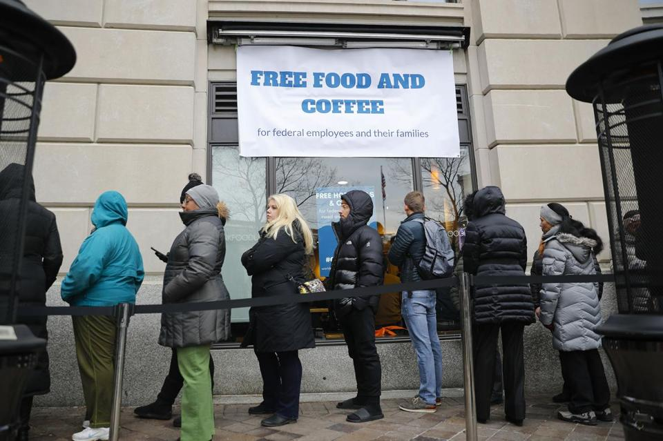 People lined up on Pennsylvania Avenue in Washington at chef Jose Andres's World Central Kitchen for free meals for federal workers affected by the government shutdown.