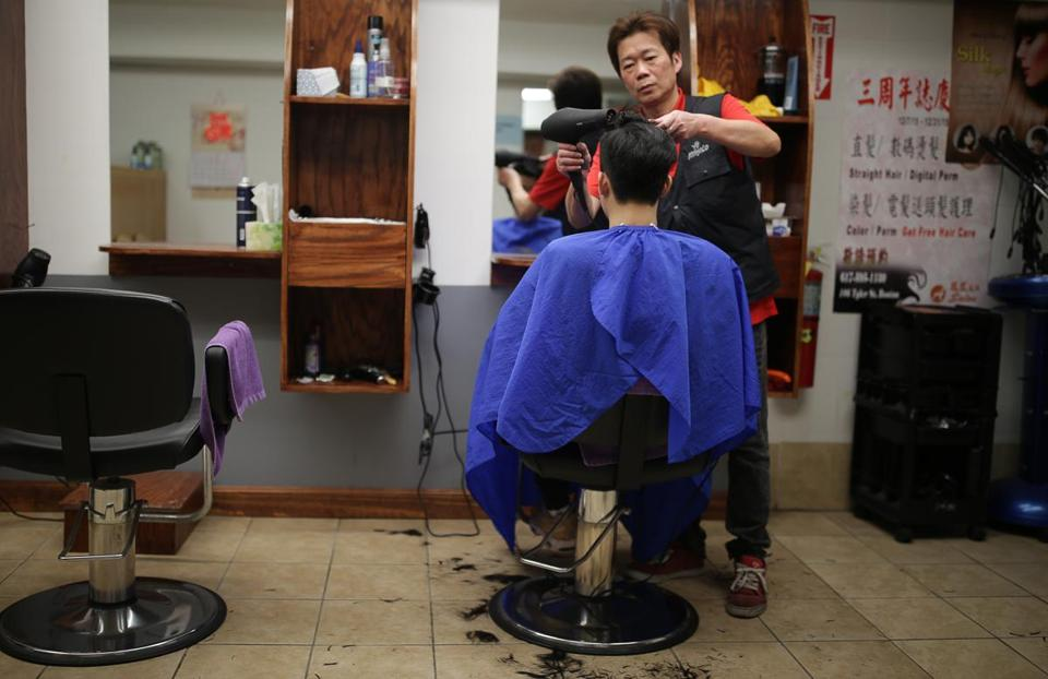 01/24/2019 Boston MA -YenChi Chen (cq) with his customer Barry Lei (cq) at his A Salon in Chinatown. Jonathan Wiggs/Globe StaffReporter:Topic: