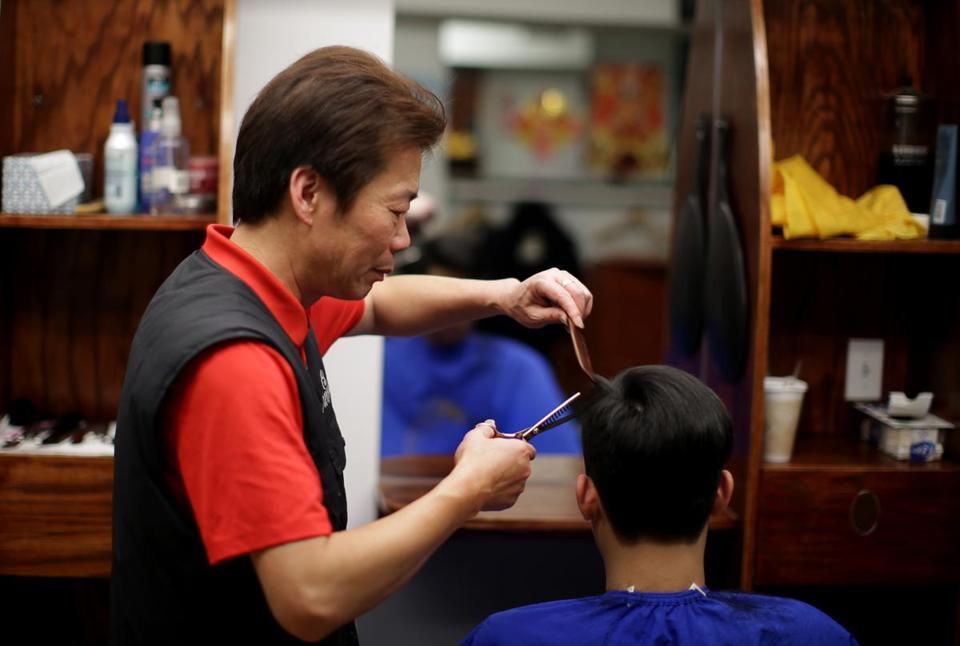 01/24/2019 Boston MA -YanChi Chin (cq) with his customer Barry Lei (cq) at his A Salon in Chinatown. Jonathan Wiggs/Globe StaffReporter:Topic: