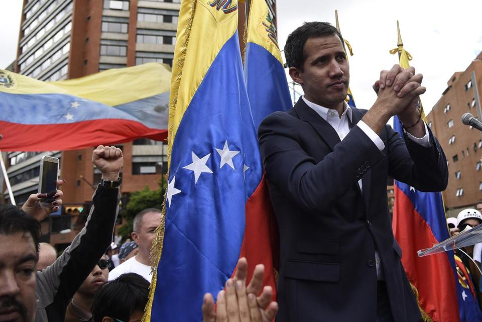 Juan Guaido gestures to a crowd in Caracas, Venezuela, on Wednesday, Jan. 23, 2019. MUST CREDIT: Bloomberg photo by Carlos Becerra