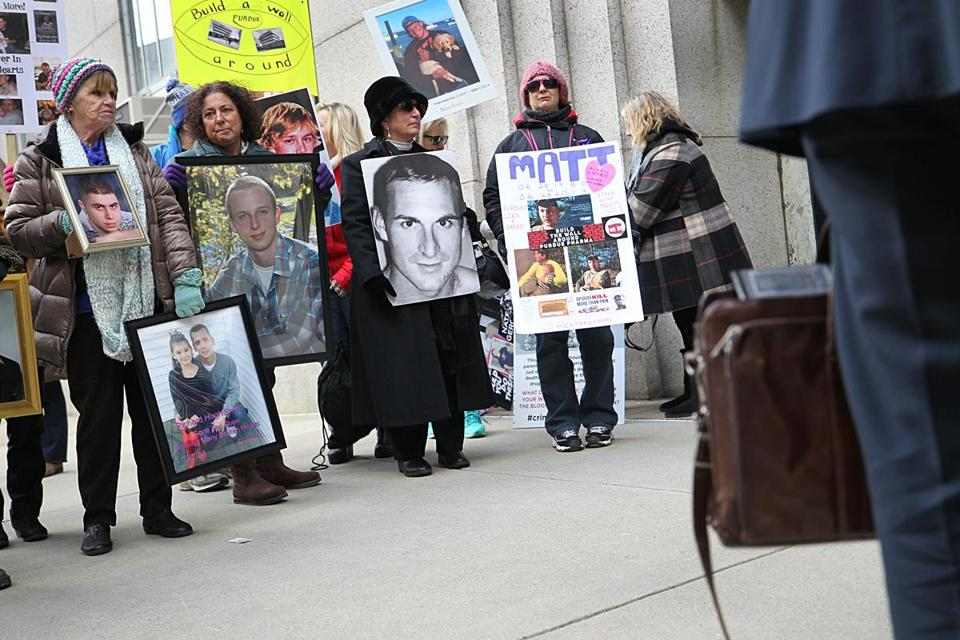 Boston, Ma., 01/25/2019, Families who have lost loved ones to the opiod crisis, protest in front of Suffolk Superior Court as lawyers for Purdue Pharma enter the courthouse for a status update in the AG's suit against Purdue Pharma. A number of media organizations, including the Globe, argued that the judge should unredact additional information that is currently redacted in the AG's suit. Suzanne Kreiter/Globe staff