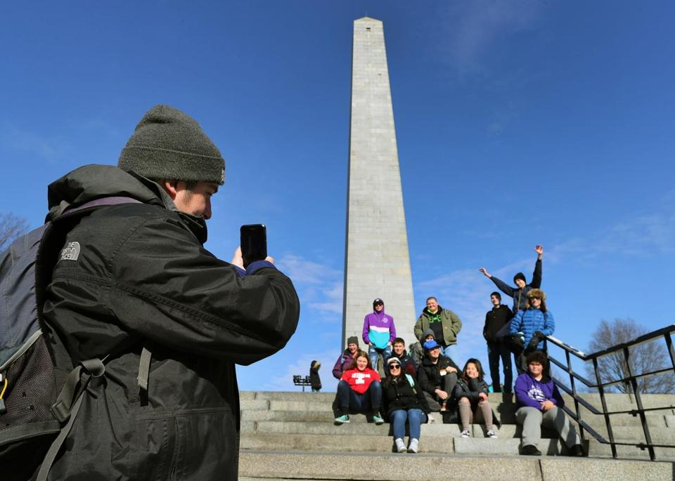 Brandon Caron from Rockland, Maine, took a photo at the Bunker Hill Monument of the teens from his mentor group.