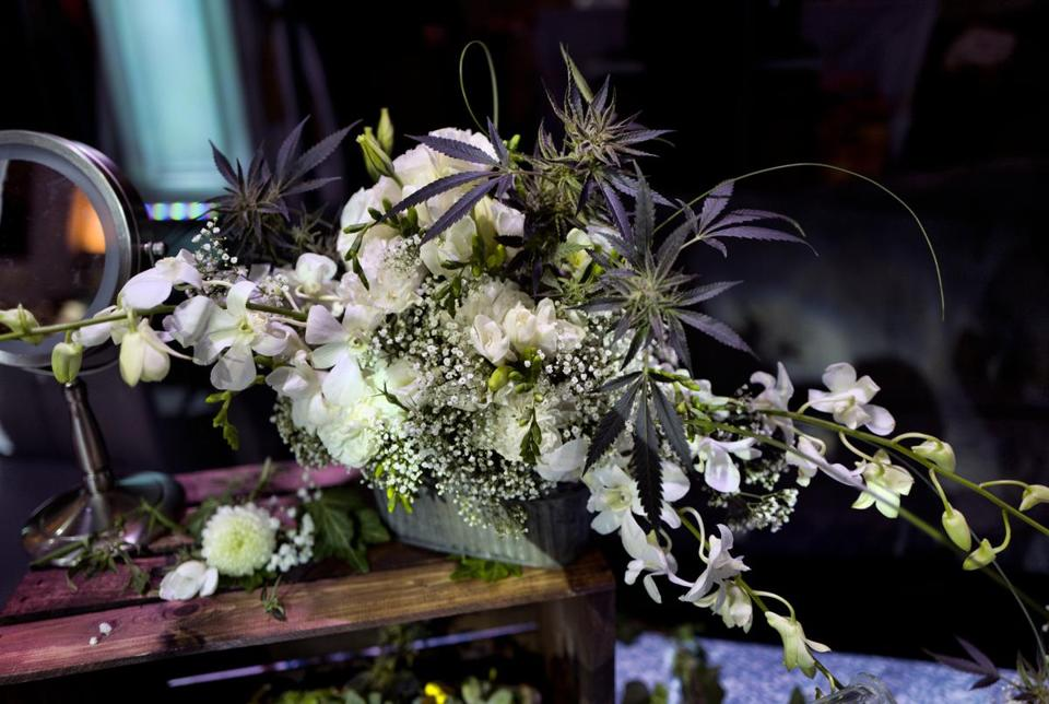 A bouquet handcrafted with fresh flowers, as well as fresh cannabis flowers is displayed at the Bitchin' Bouquets booth during the Cannabis Wedding Expo in Los Angeles on Saturday, Jan. 26, 2019. (AP Photo/Richard Vogel)