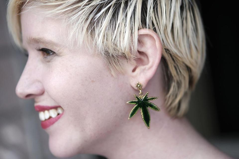 Alice Campbell from Irie Weddings and Events sports a marijuana earing during the Cannabis Wedding Expo in Los Angeles on Saturday, Jan. 26, 2019. (AP Photo/Richard Vogel)