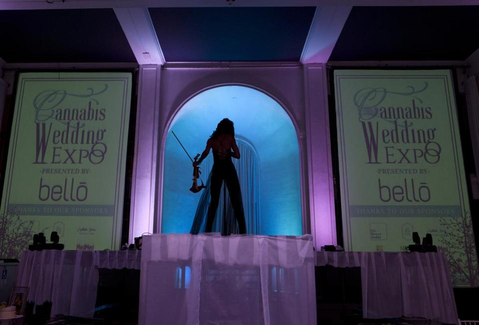 Violinist Crissy J plays on stage during the Cannabis Wedding Expo in Los Angeles on Saturday, Jan. 26, 2019. (AP Photo/Richard Vogel)