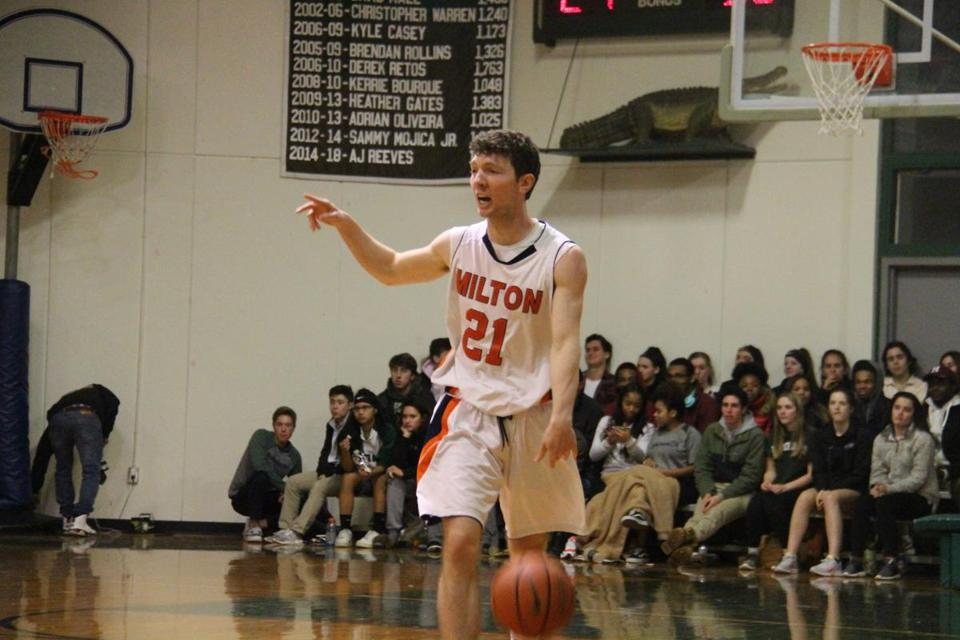 Milton Academy senior point guard Jake Seeherman runs the Mustangs' offense at Brimmer & May.