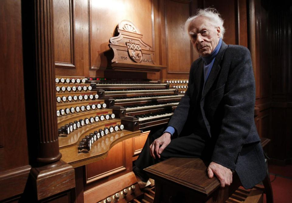 Jean Guillou, posed at the pipe organ of the Saint-Eustache Church in Paris, saw it as his life's mission to emancipate the organ from the bonds of the church, his biographer said.