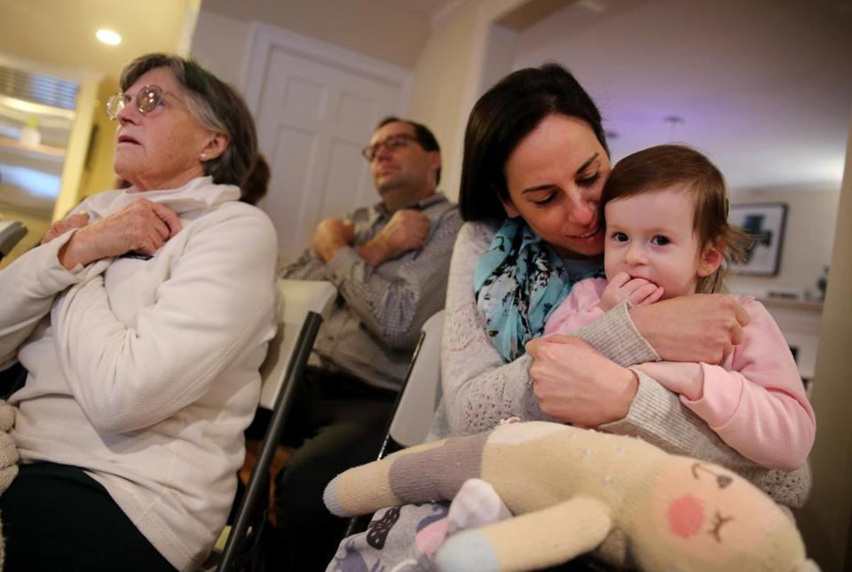 "Glenda Savitz held her 2-year-old daughter, Samantha, while signing the word ""love"" during a sign language class at a neighbor's home."