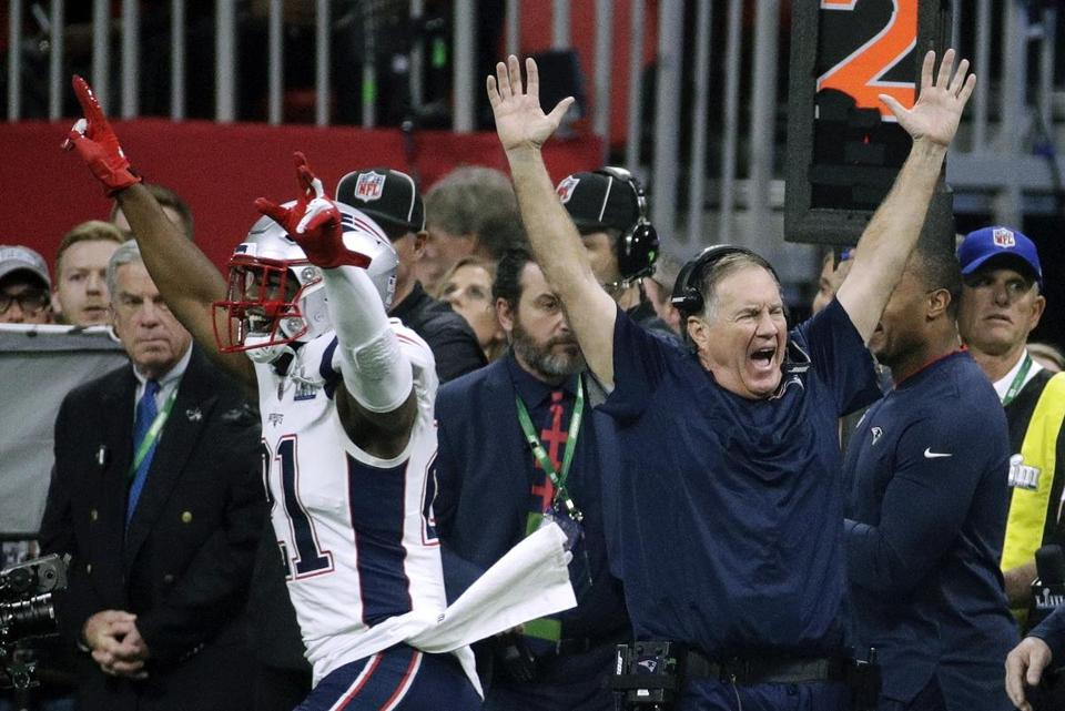New England Patriots' Duron Harmon (21) and head coach Bill Belichick celebrate after the NFL Super Bowl 53 football game against the Los Angeles Rams Sunday, Feb. 3, 2019, in Atlanta. The Patriots won 13-2. (AP Photo/Patrick Semansky)