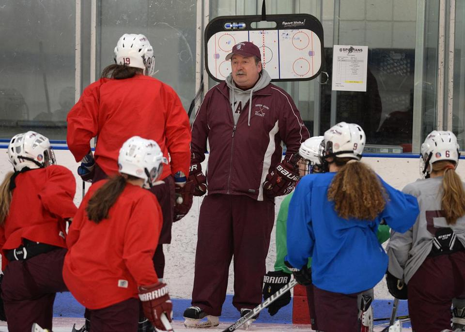 Bishop Stang coach Bill Theodore coaches the team during a practice at the Hetland Memorial Arena.