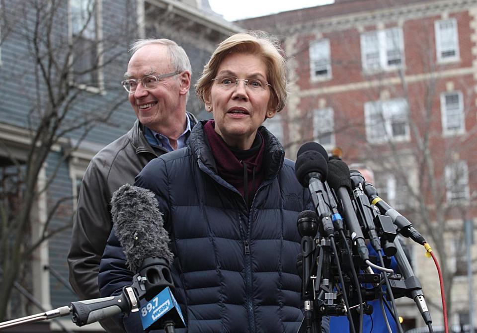 Cambridge, Ma., 12/31/2018, Senator Elizabeth Warren and her husband Bruce and dog Bailey greet the media outside her home after announcing she has launched an exploratory committee for President 2020. Suzanne Kreiter/Globe staff