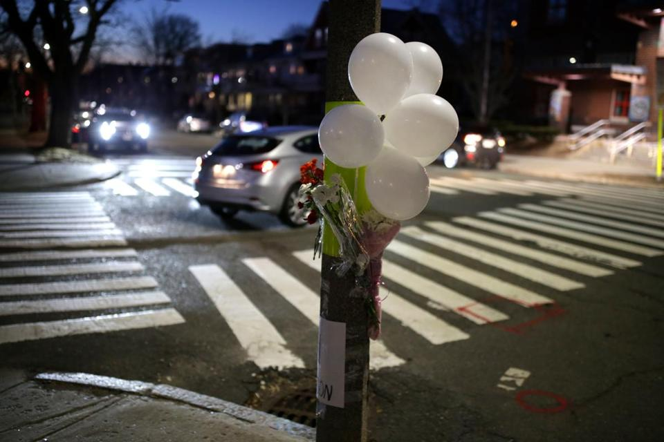 A makeshift memorial stood Saturday at the intersection where the crash happened.