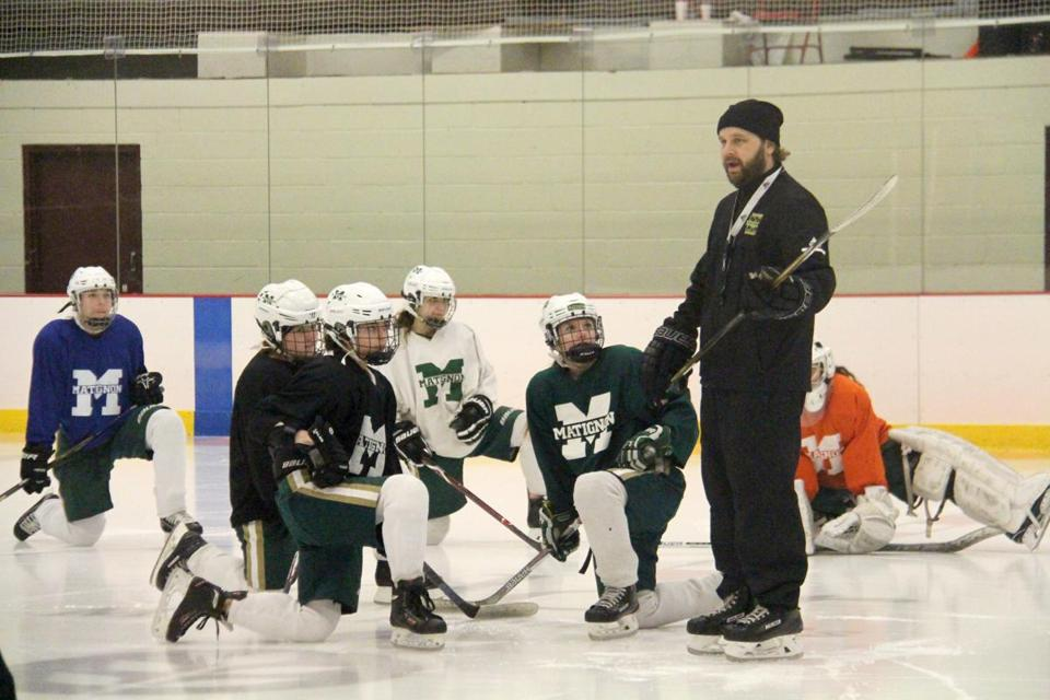 Charlestown, MA: 02-08-2019: Coach Anthony Cornacchia addresses the Matignon girls hockey team at practice on Friday in Charlestown. CREDIT: Matt MacCormack/For the Globe