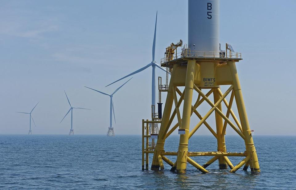 Clean-energy mandates in several states require utilities to secure wind power. Above, a wind farm near Block Island.