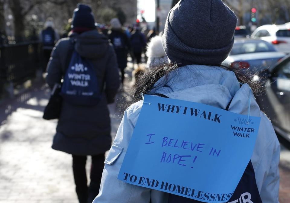 One participant had a sign on her back during the walk.