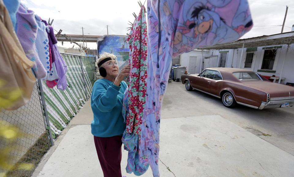 Mickie Subia gathered her laundry last month at her home in El Paso. Subia lives less than a block away from a barrier that runs along the Texas-Mexico border.