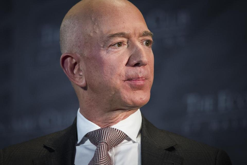 Jeff Bezos, Amazon founder and CEO, claims the National Enquirer's parent company threatened to publish explicit photos of him unless he stopped investigating how the Enquirer obtained his private exchanges with his mistress.