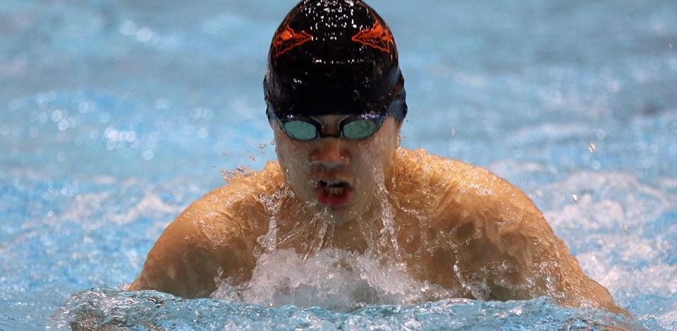Wayland's Jiming Xu took first in the 100 Breast stroke, at the MIAA North boys' swimming and diving championships at MIT's Zesiger Sports and Fitness Center. Mark Lorenz for the Boston Globe.