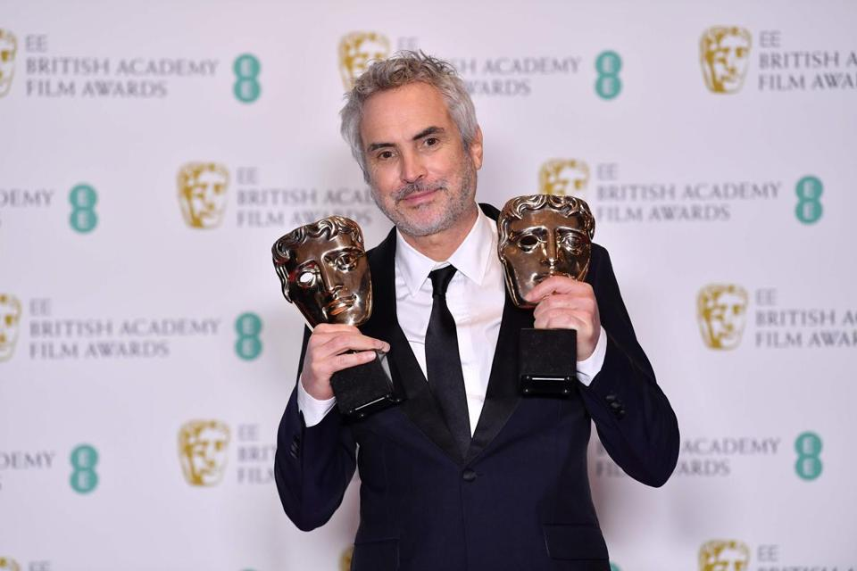 Mexican director Alfonso Cuaron poses with the awards for a Director and for Best Film for 'Roma' at the BAFTA British Academy Film Awards at the Royal Albert Hall in London on February 10, 2019 (Photo by Ben STANSALL / AFP)BEN STANSALL/AFP/Getty Images