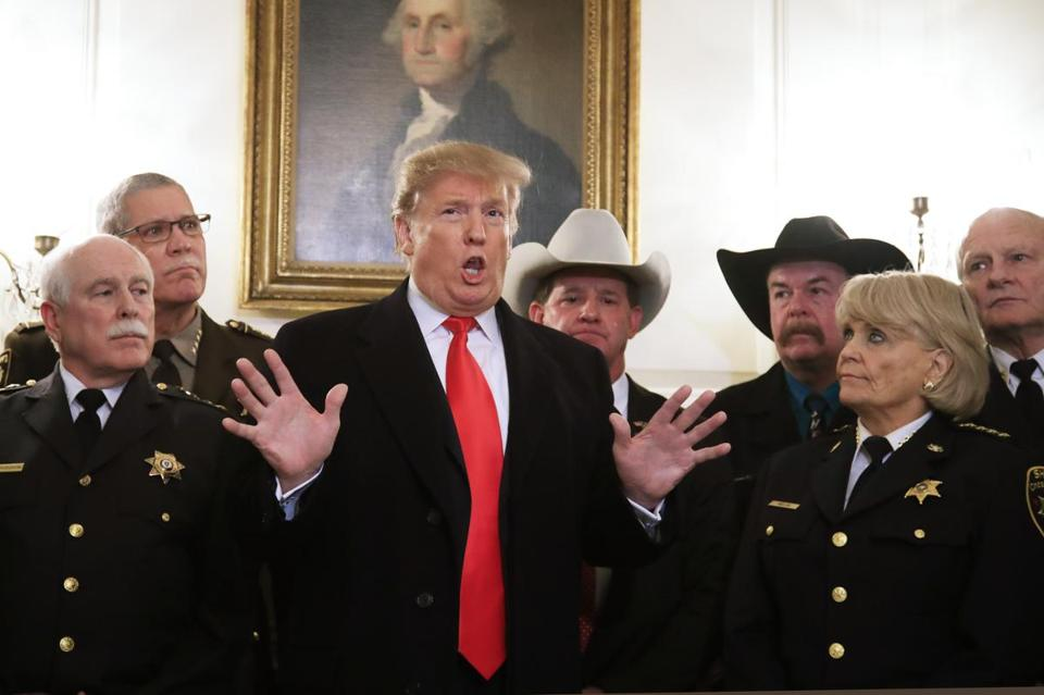 President Donald Trump speaks during a meeting with a group of sheriffs from around the country before leaving the White House in Washington, Monday, Feb. 11, 2019, for a trip to El Paso, Texas. (AP Photo/Manuel Balce Ceneta)
