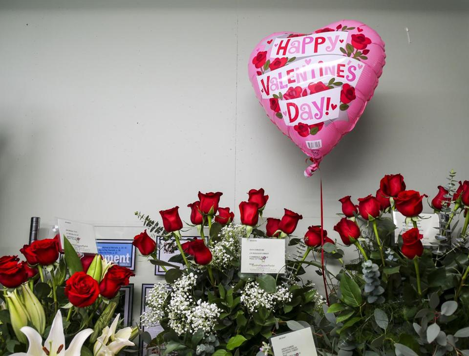 Bouquets of roses ordered in advance for Valentines Day sit in storage at Central Square Florist on Monday morning.