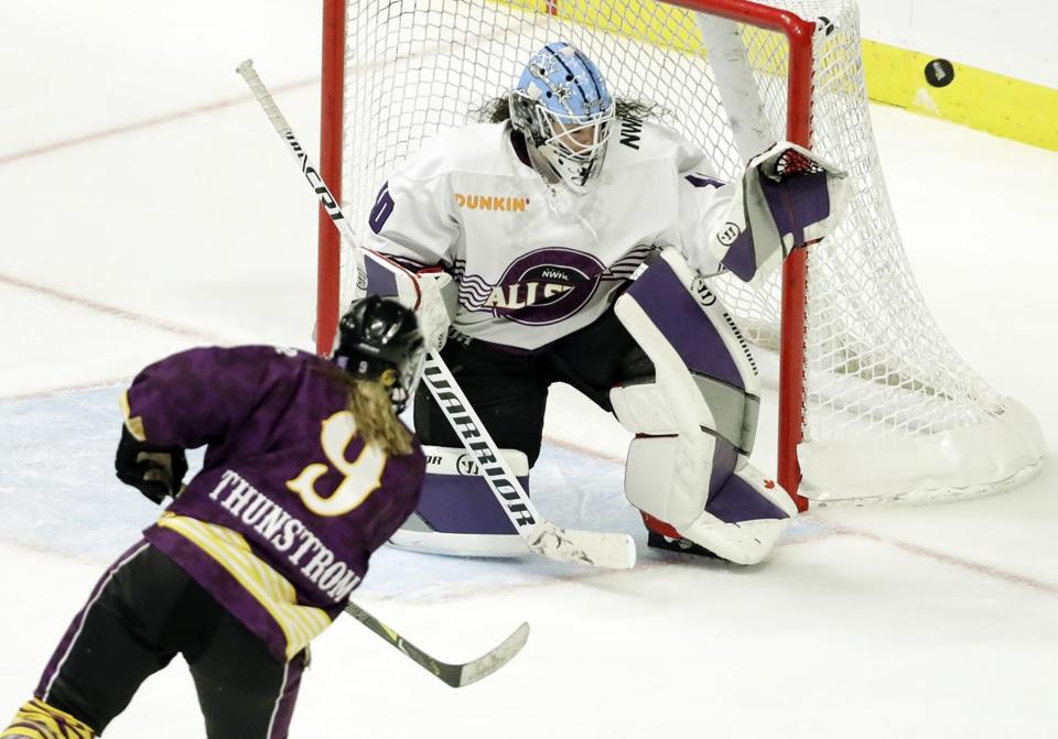 Team Stecklein forward Allie Thunstrom shoots against Team Szabados goalie Shannon Szabados in the NWHL All-Star Game in Nashville.
