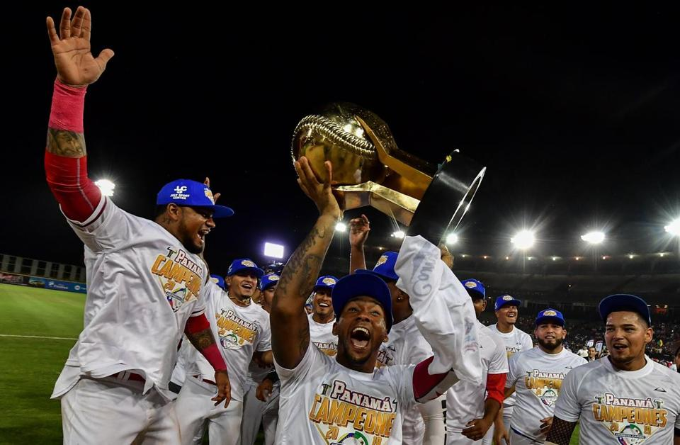 Players from Panama's Toros de Herrera celebrate with the trophy after their victory over Cuba in the Caribbean Series finale at Rod Carew Stadium in Panama City.