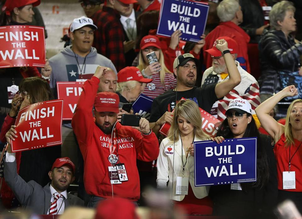 Supporters of a border wall with Mexico attended a rally held by President Trump in El Paso Monday.