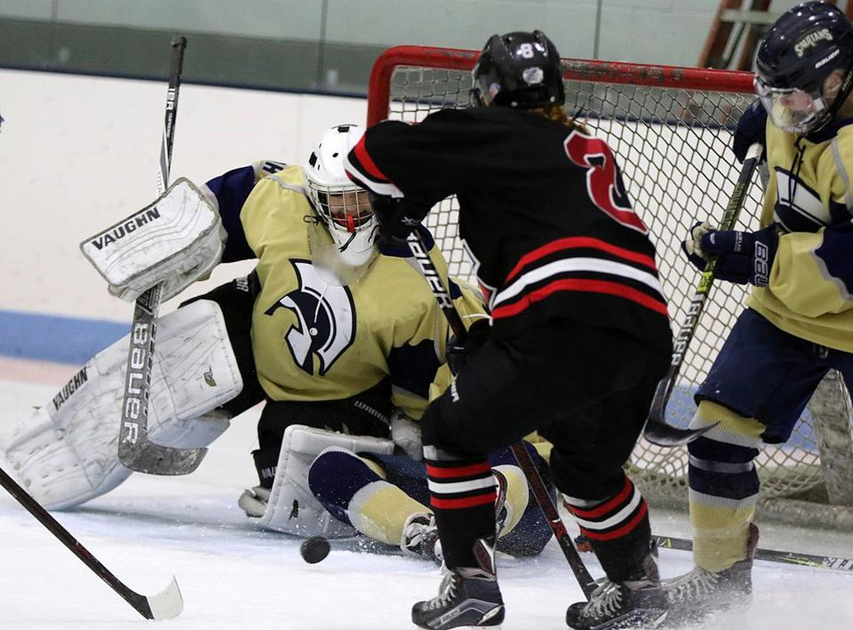 Marblehead's Cate Delaney can't sneak this shot by St. Mary's goalie Lauren Vaccaro in matchup at the Willam Connery MDC Rink in Lynn. Mark Lorenz for the Boston Globe.