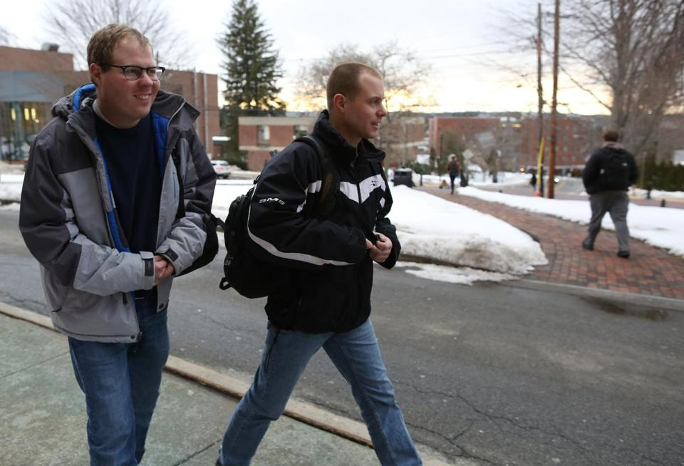 Johan Rijk (left) and his brother, Matt, left class at Framingham State University.