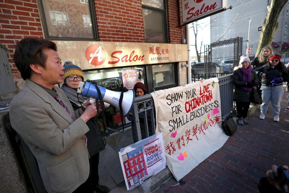 BOSTON, MA - 2/14/2019: Outside his shop speaking at his rally, Yan Chi Chen who has run a hair salon at 106 Tyler St in Boston's Chinatown, which is a row house with 4 apartments above a ground floor commercial space. He is facing eviction, a court trial at the Edward Brooks courthouse. But before leaving for court there was a small rally for him in Chinatown.....they met at the salon before going to courthouse. (David L Ryan/Globe Staff ) SECTION: METRO TOPIC 15chinatown