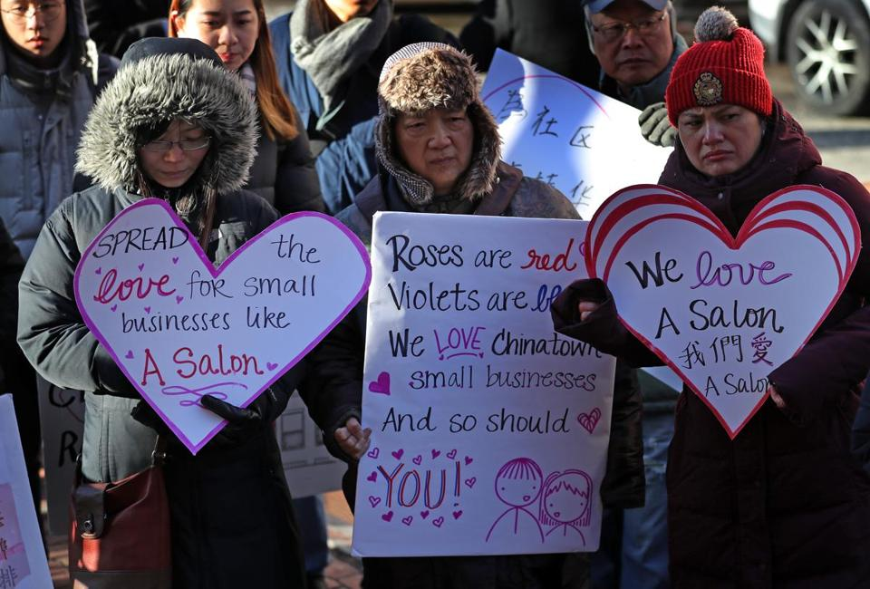 BOSTON, MA - 2/14/2019: Support with heart shape signs for Yan Chi Chen who has run a hair salon at 106 Tyler St in Boston's Chinatown, which is a row house with 4 apartments above a ground floor commercial space. He is facing eviction, a court trial at the Edward Brooks courthouse. But before leaving for court there was a small rally for him in Chinatown.....they met at the salon before going to courthouse. (David L Ryan/Globe Staff ) SECTION: METRO TOPIC 15chinatown