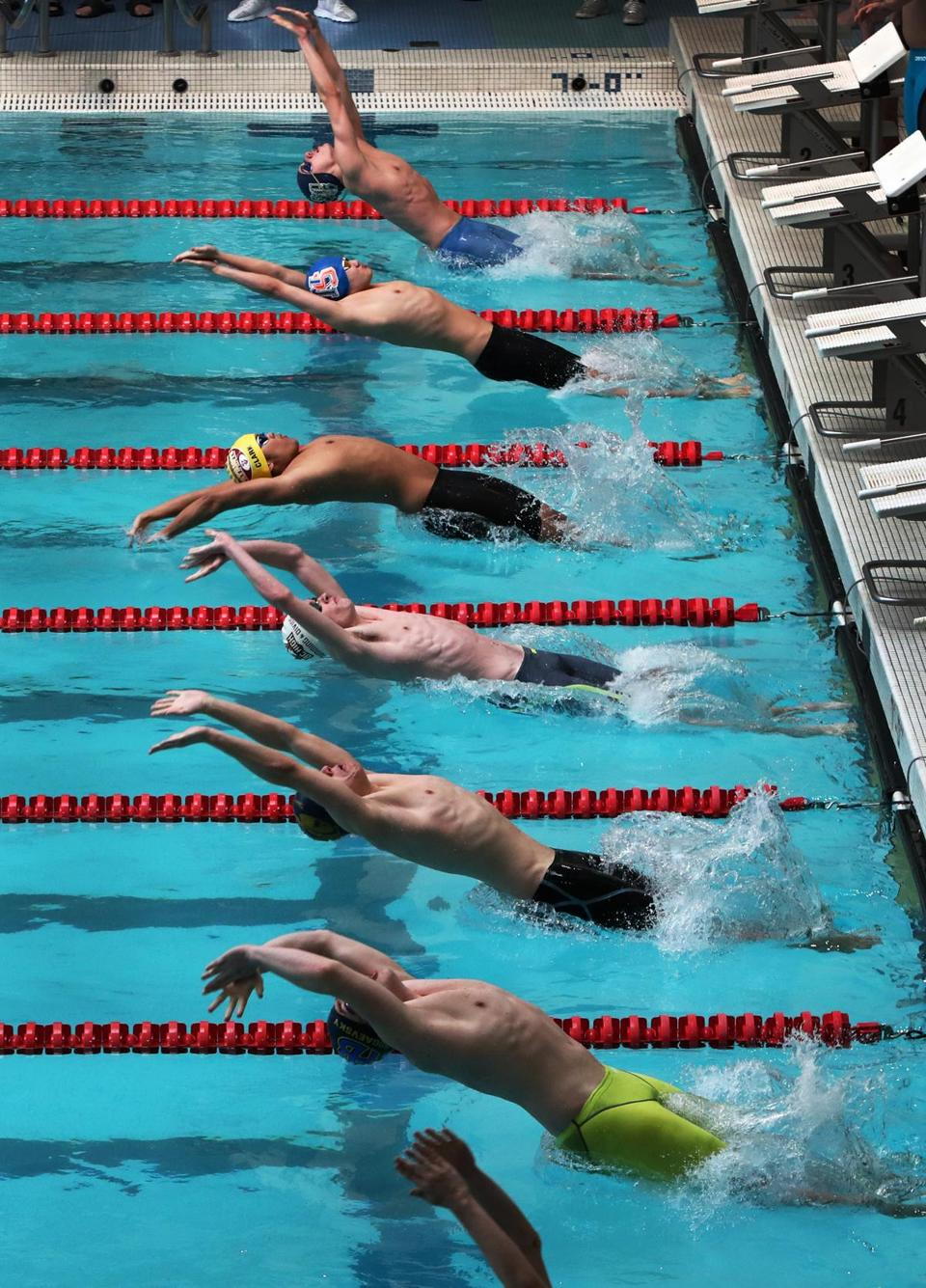 2-17-19 Boston, MA: Participants in a heat of the 200 Yard Medley Relay are pictured as they begin the race during the State Division One Boy's Swimming and Diving Championships held at Boston University. (Jim Davis /Globe Staff)