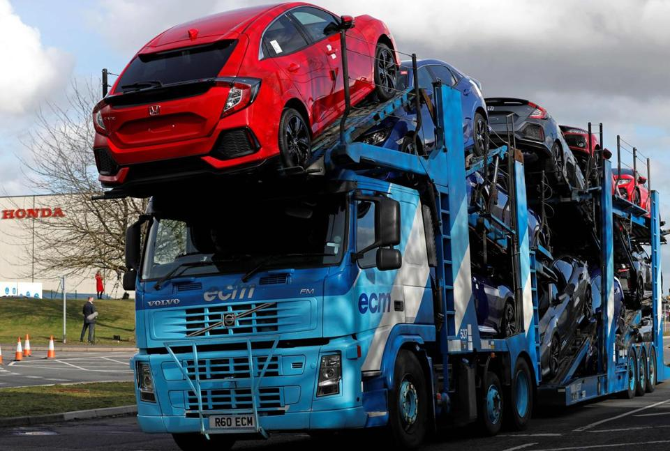"A car transporter loaded with new Honda vehicles is driven out of the Honda manufacturing plant in Swindon, southwest England on February 19, 2019. - Honda announced Tuesday it would shut a major plant in Britain, putting 3,500 jobs at risk as the auto manufacturer became the latest Japanese firm to downsize operations as Brexit looms. The factory in Swindon, southwest England, is Honda's only EU plant and has produced the manufacturer's ""Civic"" model for more than 24 years, with 150,000 units rolling off the line annually. (Photo by Adrian DENNIS / AFP)ADRIAN DENNIS/AFP/Getty Images"