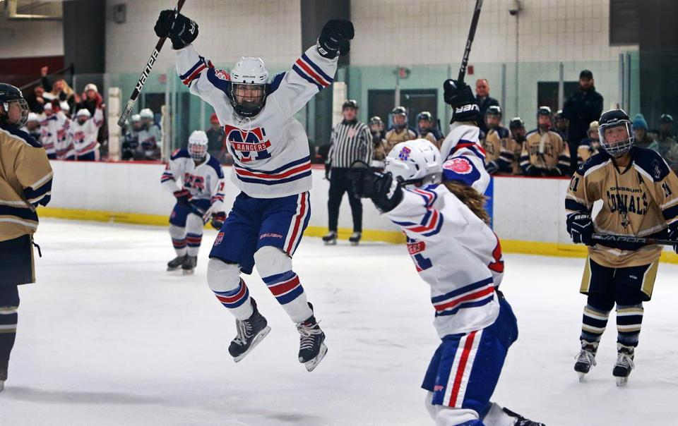 2-19-19 Newburyport, MA: Methuen-Tewksbury's Cassidy Gruning leaps in celebration after she scored a first period goal to put her team ahead 1-0. Teammate Julia Masotta (19) is pictured at right about to join the party. Methuen-Tewksbury took on Newburyport in a girl's high school hockey game as part of the Newburyport Bank Classic tournament held at the Graf Rink. (Jim Davis /Globe Staff)