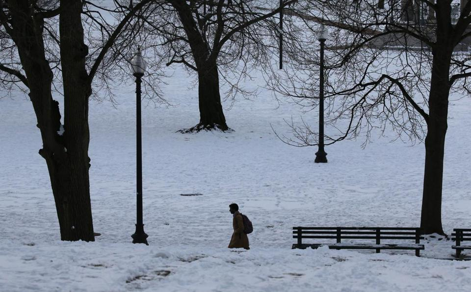 A pedestrian passed through Boston Common on Wednesday.