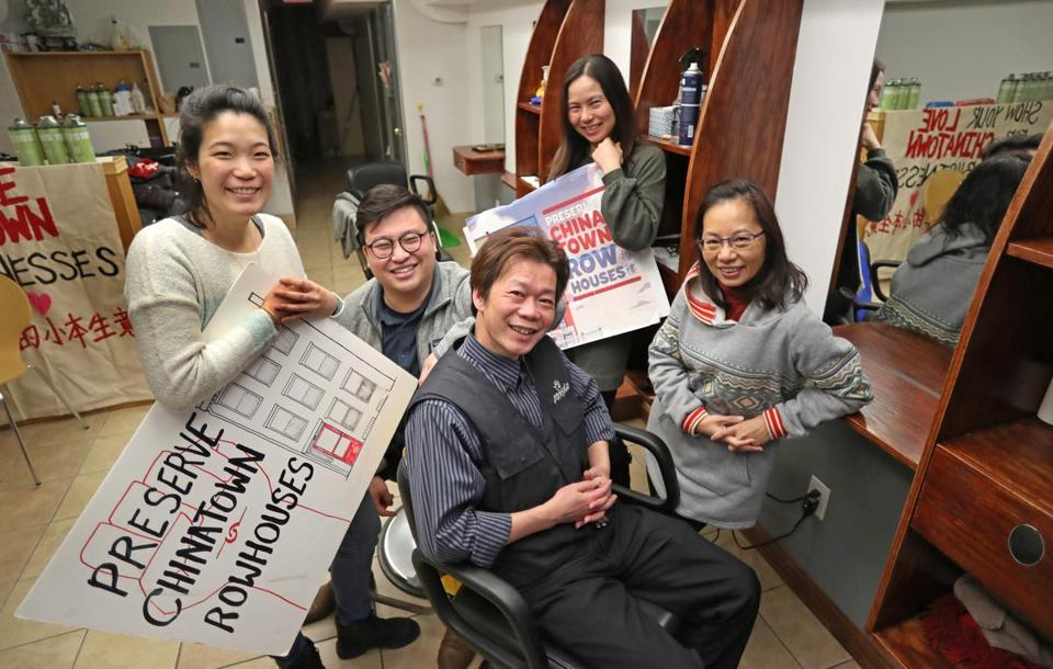 BOSTON, MA - 2/20/2019:ALL SMILES.....surrounded by Chinese Progressive Association staff members , Chinatown hair salon owner, Yan Chi Chen seated center who has run a hair salon at 106 Tyler St in Boston's Chinatown, settles with his landlord out of court and to his advantage, he won't be displaced. (David L Ryan/Globe Staff ) SECTION: METRO TOPIC 21chinatownphoto