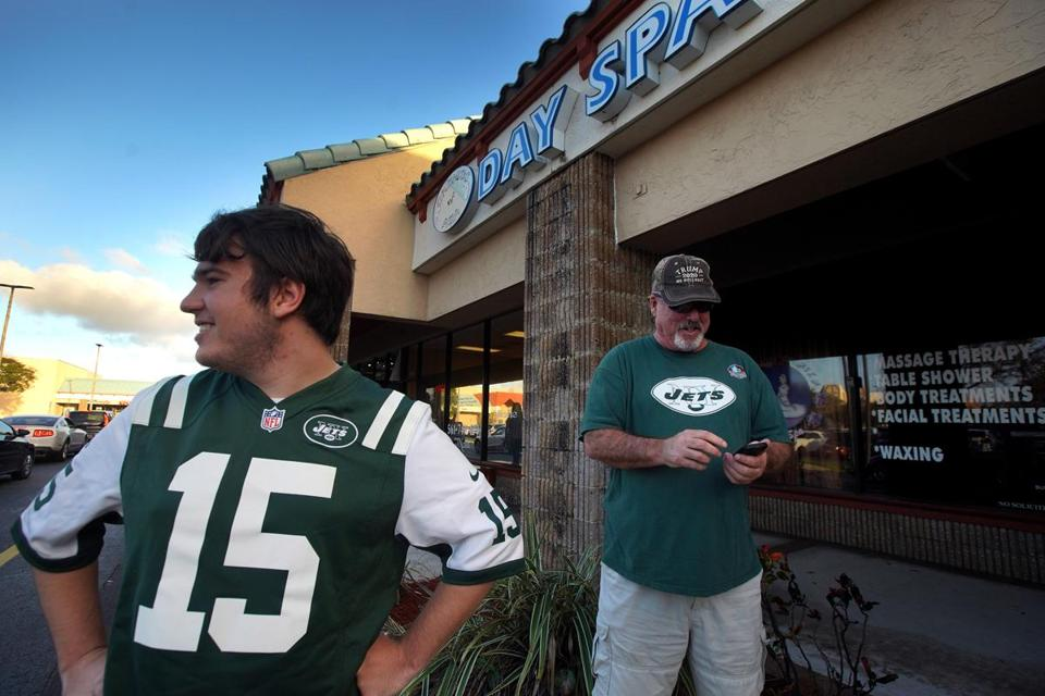 Jupiter, FL - 2/22/2019 - News of New England Patriots owner being charged with solicitation of prostitution at Orchids of Asia Day Spa in Jupiter, FL brought New York Jets fans Matthew Gizze and Mike Brown to the scene. - (Barry Chin/Globe Staff), Section: Meter, Reporter: Globe Staff, Topic: 23Robert Kraft, LOID: 8.5.498743325.