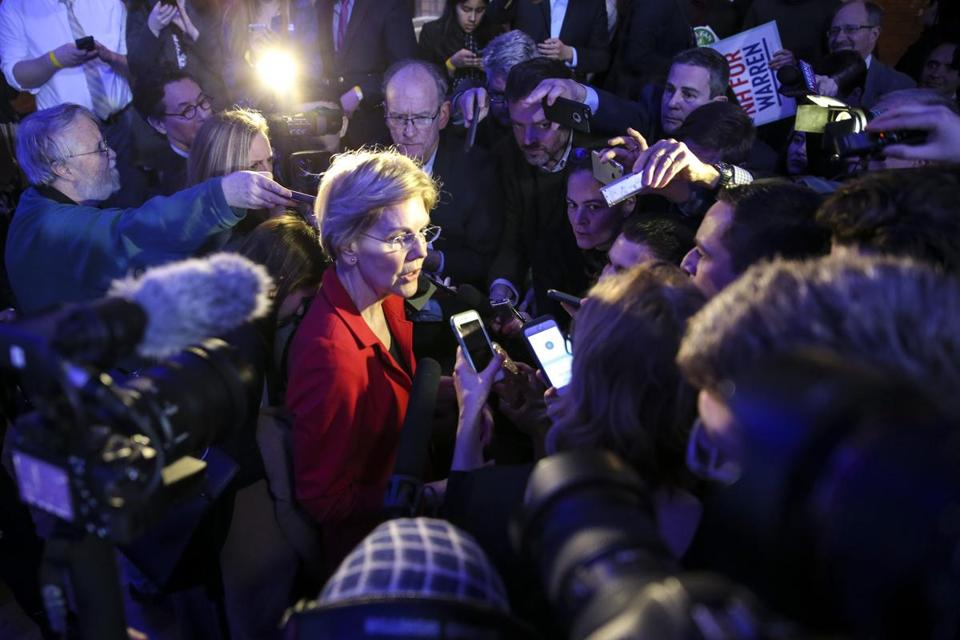 Manchester, NH--02/22/2019--Senator Elizabeth Warren answers questions from the media after the New Hampshire Democratic Party's 60th annual McIntyre-Shaheen 100 Club Dinner in Manchester, NH Friday evening. (Nathan Klima for The Boston Globe) Topic: 23NHDemocrats Reporter: