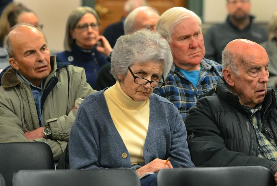 The crowd listens as the Hingham Advisory Committee ask questions of Aquarion executives; The shovel used to break ground for the original Hingham Water Co. in 1879.