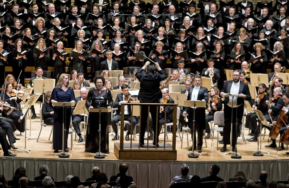 Andris Nelsons conducts the Boston Symphony Orchestra, the Tanglewood Festival Chorus, and soloists (standing, from left) Rachel Willis-Sorensen, Violeta Urmana, Dmytro Popov, and Matthew Rose at Symphony Hall Thursday.